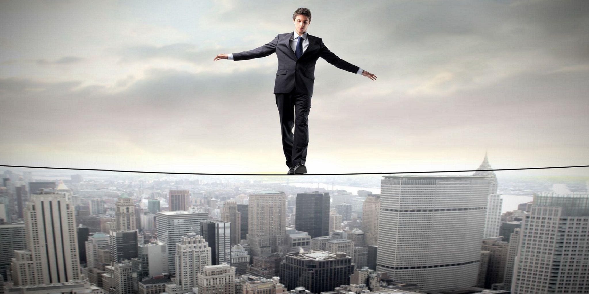 Businessperson keeping their balance